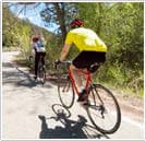 two bicyclists on a trail
