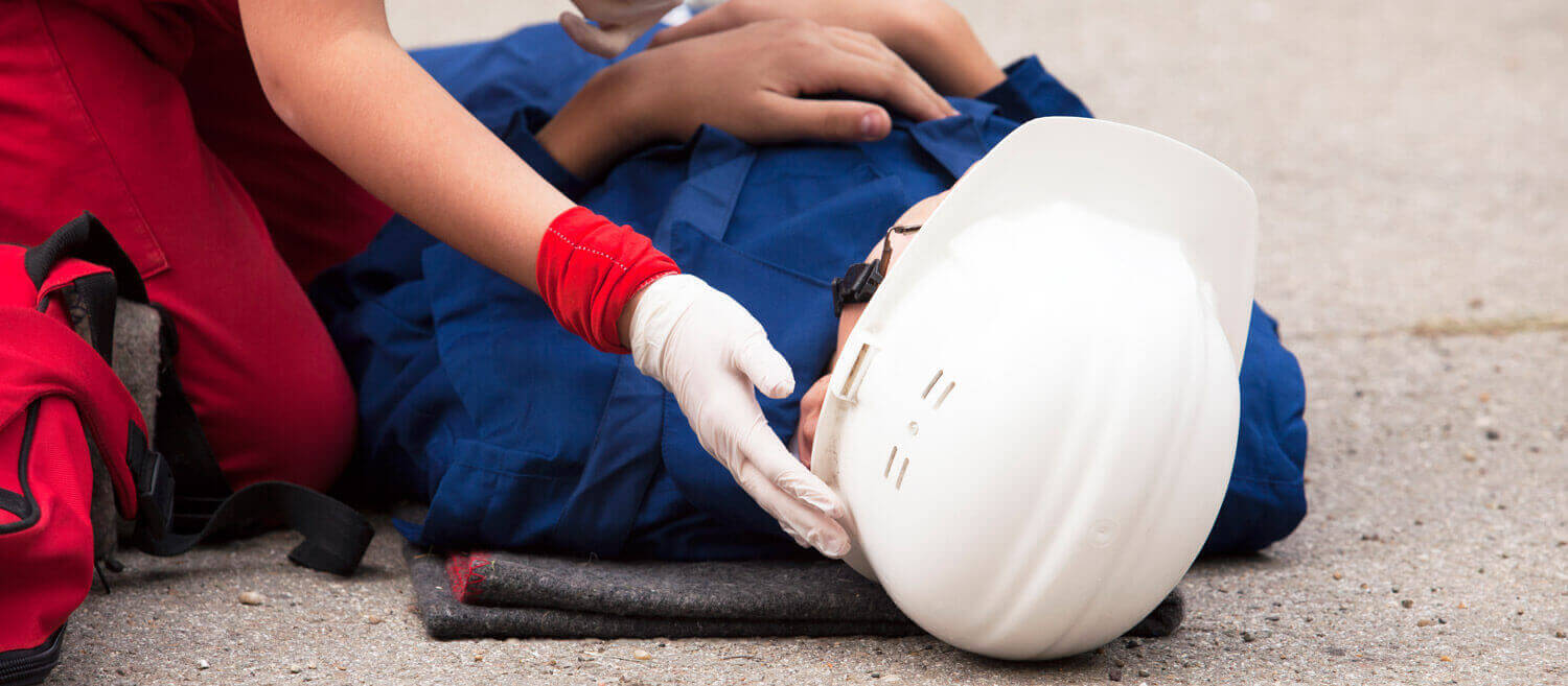 An injured worker is cared for by EMT's