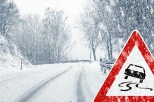 snowy curve caution sign