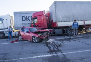 car and semi truck accident scene